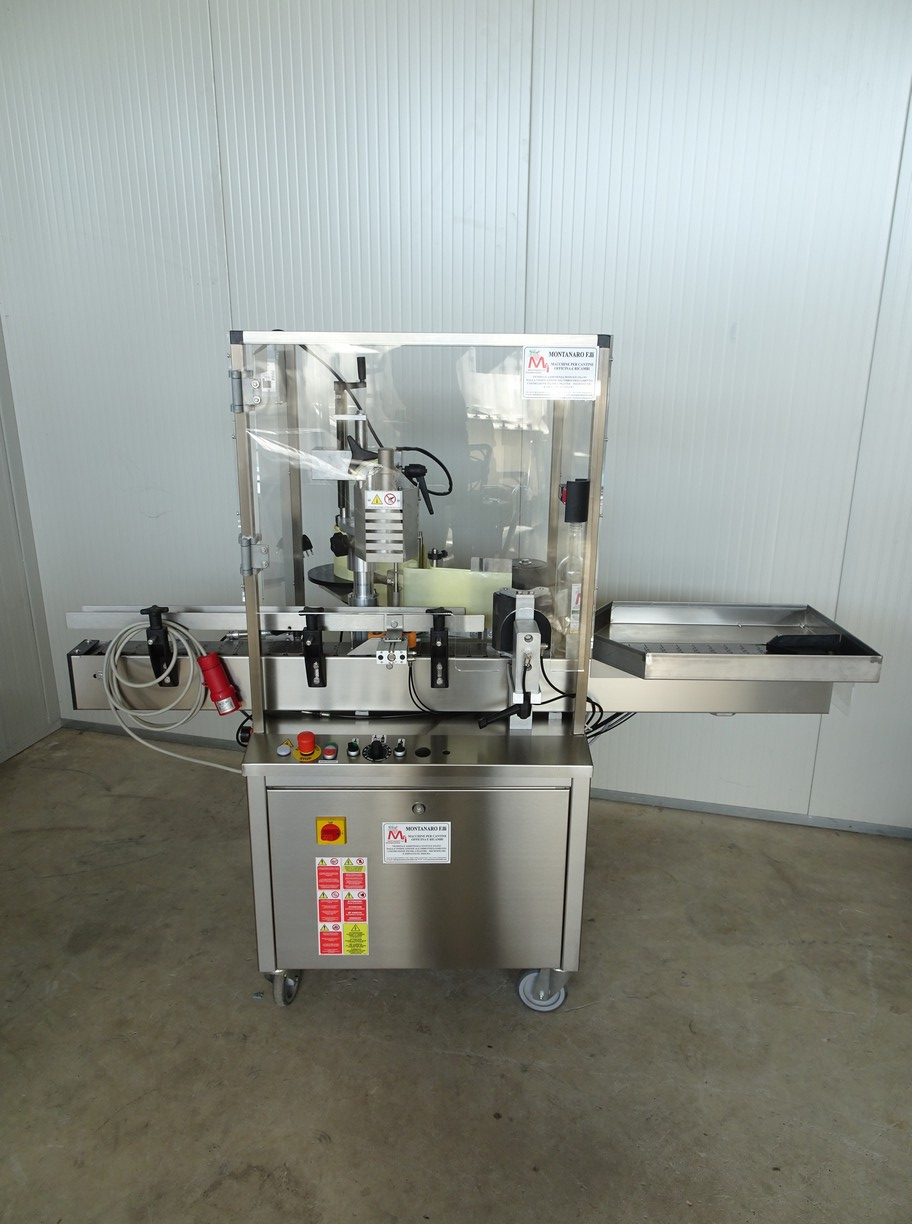 ONE STATION ADHESIVE LABELLING MACHINE FOR LABEL AND BACK ON THE SAME ROLL NEW MACHINE