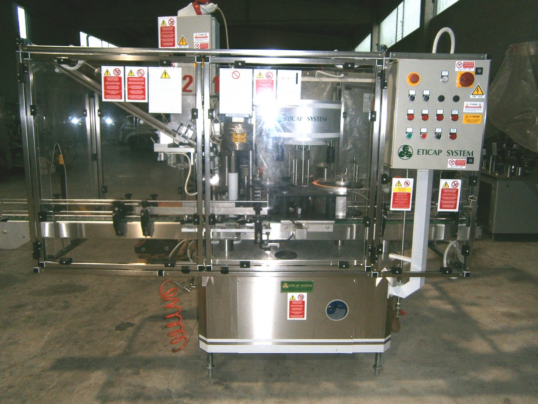 LABELLING MACHINE ETICAP SYSTEM 3 LOACKING HEADS 2 STATIONS FOR APPLY LABEL AND BACK LABEL SECOND-HAND MACHINE